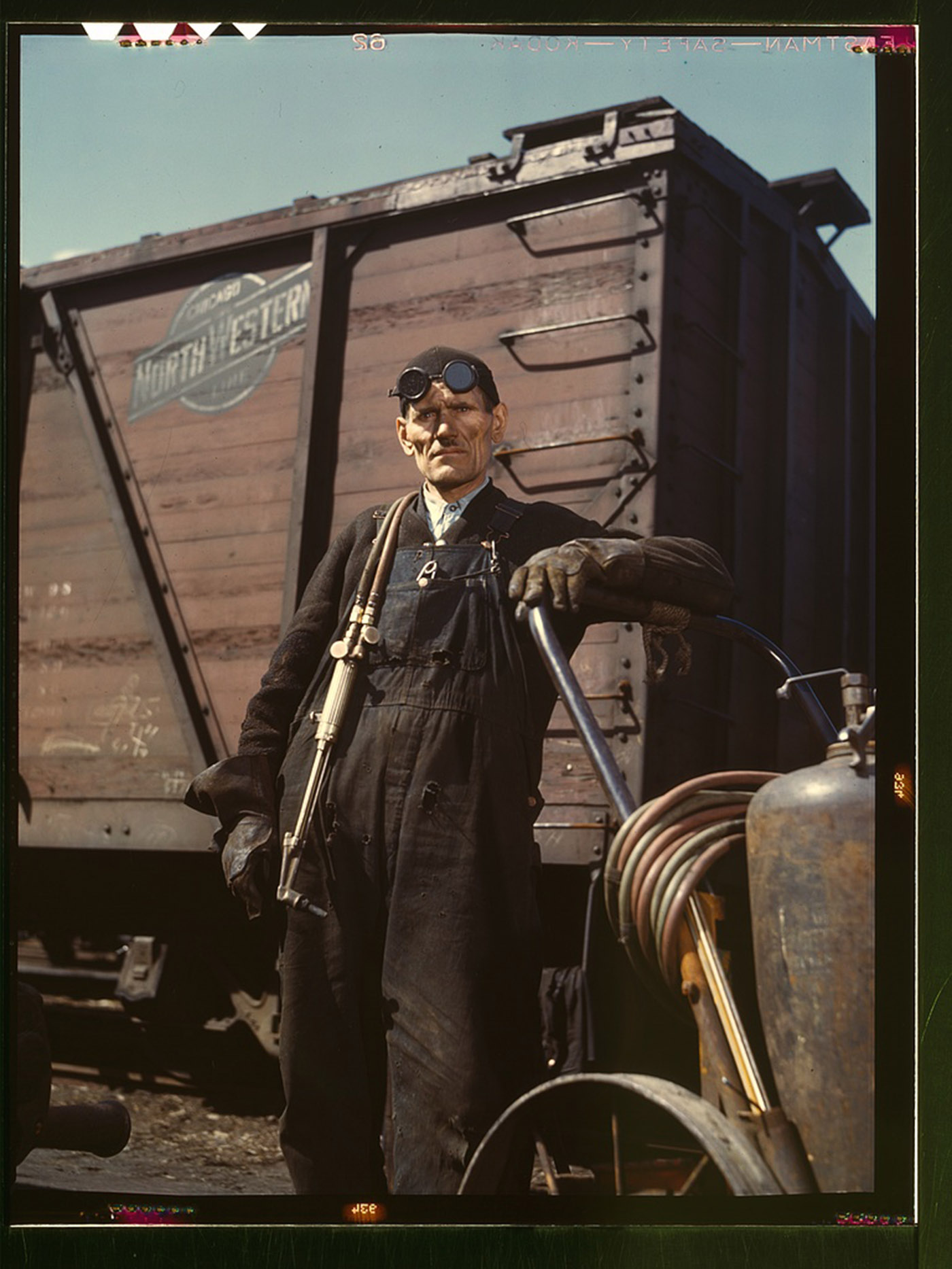 Mike Evans, a welder, at the rip tracks at Proviso yard of the C & NW RR, Chicago, Illinois, 1943. Mike Evans, a welder, at the rip tracks at Proviso yard of the C & NW RR, Chicago, Ill. Mike Evans, a welder, at the rip tracks at Proviso yard of the C & NW RR, Chicago, Ill. Jack Delano, Farm Security Administration/Office of War Information