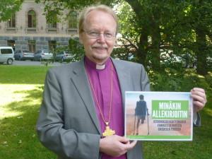Arkkipiispa allekirjoittaa Tasaus-keräyksen