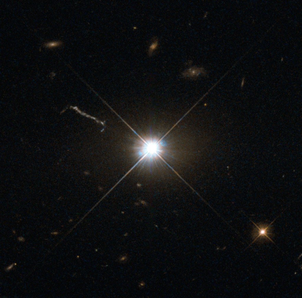 "This image from Hubble's Wide Field and Planetary Camera 2 (WFPC2) is likely the best of ancient and brilliant quasar 3C 273, which resides in a giant elliptical galaxy in the constellation of Virgo (The Virgin). Its light has taken some 2.5 billion years to reach us. Despite this great distance, it is still one of the closest quasars to our home. It was the first quasar ever to be identified, and was discovered in the early 1960s by astronomer Allan Sandage. The term quasar is an abbreviation of the phrase ""quasi-stellar radio source"", as they appear to be star-like on the sky. In fact, quasars are the intensely powerful centres of distant, active galaxies, powered by a huge disc of particles surrounding a supermassive black hole. As material from this disc falls inwards, some quasars — including 3C 273  — have been observed to fire off super-fast jets into the surrounding space. In this picture, one of these jets appears as a cloudy streak, measuring some 200 000 light-years in length. Quasars are capable of emitting hundreds or even thousands of times the entire energy output of our galaxy, making them some of the most luminous and energetic objects in the entire Universe. Of these very bright objects, 3C 273 is the brightest in our skies. If it was located 30 light-years from our own planet — roughly seven times the distance between Earth and Proxima Centauri, the nearest star to us after the Sun — it would still appear as bright as the Sun in the sky.   WFPC2 was installed on Hubble during shuttle mission STS-125. It is the size of a small piano and was capable of seeing images in the visible, near-ultraviolet, and near-infrared parts of the spectrum."