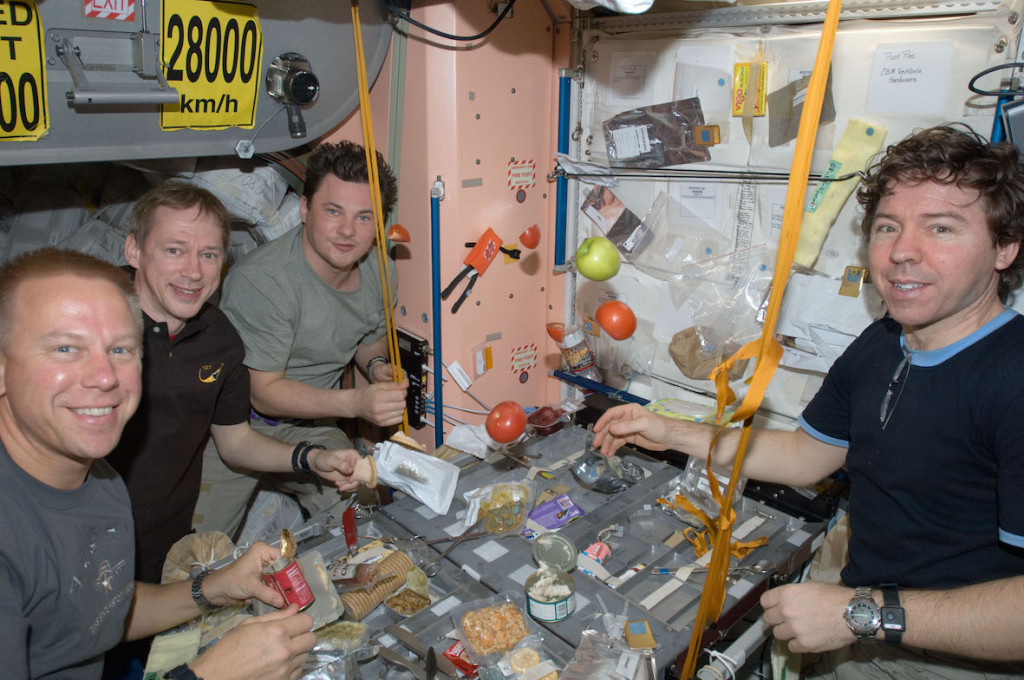 Expedition_20_crew_members_share_a_meal_at_a_galley_in_the_Unity_node_of_the_International_Space_Station_-_20090731