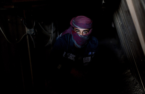 A Palestinian man smuggling tunnel in the Gaza-Egypt border of 9 December. © AFP Photo /