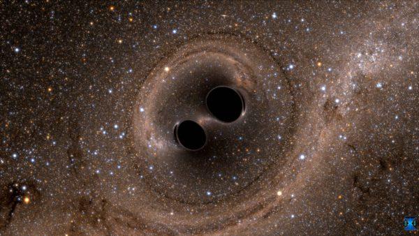 Voimakkaimmat gravitaatioaallot syntyvät mustien aukkojen törmäyksissä. Kuva tietokonesimulaatiosta.