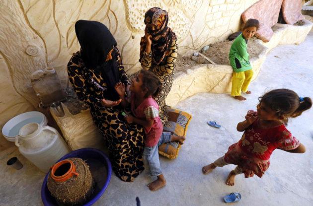 Maan sisäisiä pakolaisia Syyrian Raqqassa 14. elokuuta 2017.