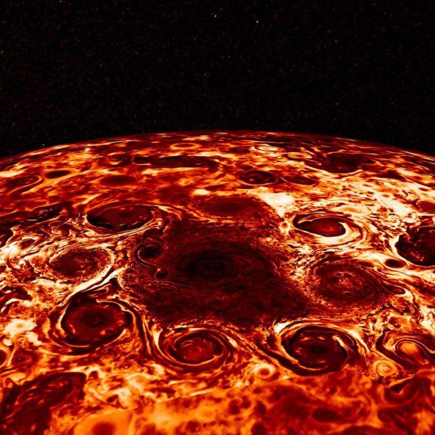 Juno-luotaimen infrapunakuvassa näkyvät Jupiterin pohjoisnavan syklonit.