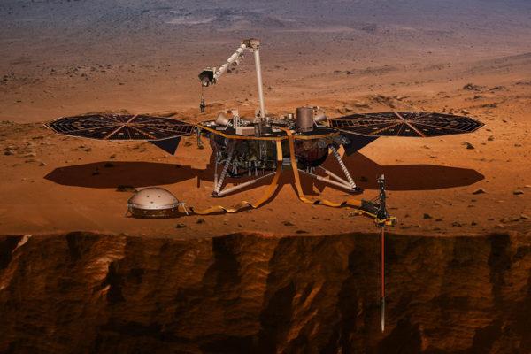 Taiteilijan näkemys InSight-laskeutujasta käytössä Marsin pinnalla.