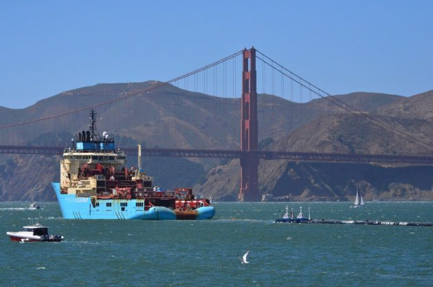 "CAEG101; A ship tows The Ocean Cleanup's first buoyant trash-collecting device toward the Golden Gate Bridge in San Francisco en route to the Pacific Ocean on Saturday, Sept. 8, 2018. Once deployed, the boom will form a U-shaped barrier to trap plastic and trash that currently makes up the ""Great Pacific Garbage Patch."" (AP Photo) AP / LEHTIKUVA / LORIN ELENI GILL"