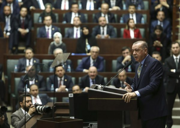 XLP114; Turkey's President Recep Tayyip Erdogan addresses members of his ruling Justice and Development Party (AKP), at the parliament in Ankara, Turkey, Tuesday, Oct. 23, 2018. Saudi officials murdered Saudi writer Jamal Khashoggi in their Istanbul consulate after plotting his death for days, Erdogan said, contradicting Saudi Arabia's explanation that the writer was accidentally killed. He demanded that the kingdom reveal the identities of all involved, regardless of rank. (AP Photo) AP / LEHTIKUVA / ALI UNAL