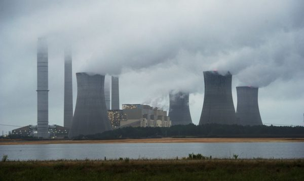 NYHK101; FILE - This June 1, 2014, file photo show the coal-fired Plant Scherer in operation in Juliette, Ga. Despite what President Donald Trump says, scientists have long known that what's warming the planet isn't natural. It's us. Climate scientists say Trump was wrong. There are several ways they know that more than 90 percent of climate change is caused by emissions of heat-trapping gases from activities like burning coal and natural gas for electricity, or burning gasoline, diesel and jet fuel for transportation. In other words, humans. (AP Photo, File) AP / LEHTIKUVA / JOHN AMIS