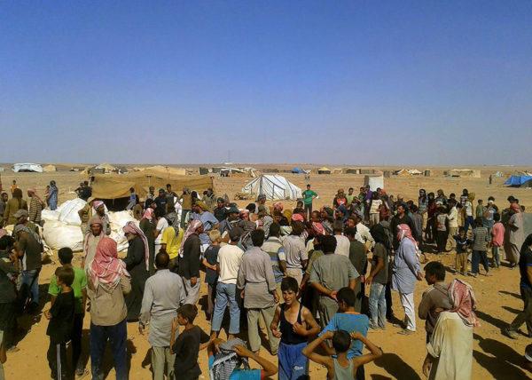 Syyrialaisia pakolaisleirissä Syyrian ja Jordanian rajalla elokuussa 2016.