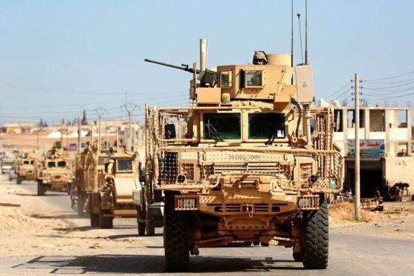 Isisin vastaisen liittouman joukkoja Manbijin kaupungissa huhtikuussa 2018.
