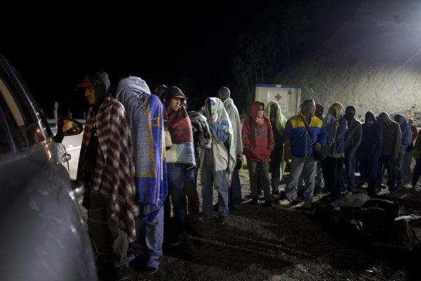 Venezuelasta naapurimaa Kolumbiaan paenneet ihmiset jonottivat leipää ja kahvia elokuussa 2018.