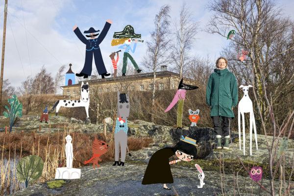 Kuvittaja Marika Maijala Helsingin Harakan saarella, jossa Maijalalla on työhuone. Kuvassa myös Maijalan piirtämiä hahmoja.
