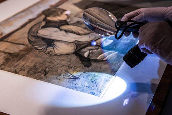Poika ja sirppi -teoksen vasemmassa alakulmassa voi erottaa Vincent van Goghin sinisen sormenjäljen.