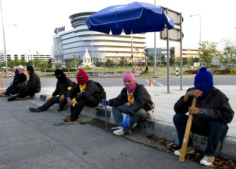 Anti-government demonstrators armed with clubs and iron bars stand watch near a checkpoint Sunday, Nov. 30, 2008, at Suvarnabhumi airport in Bangkok, Thailand.