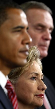 President-elect Barack Obama, left, stands with Secretary of State-designate Sen. Hillary Rodham Clinton, D-N.Y., center, and National Security Adviser-designate Ret. Marine Gen. James Jones, right, at a news conference in Chicago, Monday, Dec. 1, 2008. (AP Photo/Pablo Martinez Monsivais)