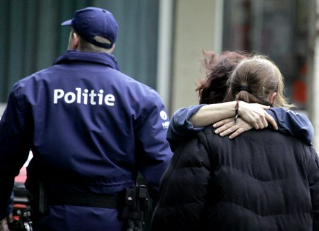 Parents comfort each other at a crisis center after a stabbing incident at a daycare center in Dendermonde, Belgium, Friday Jan. 23, 2009. An unidentified man entered the day care center Friday and stabbed to death two young children and a woman causing widespread panic, officials said. Ten children were hospitalized. (AP Photo/Virginia Mayo)