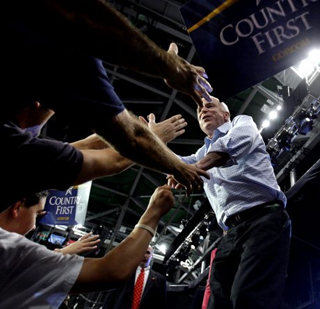 Republican presidential candidate Sen. John McCain, R-Ariz., greets supporters at a midnight rally at Tropical Park Stadium in Miami, Monday, Nov. 3, 2008. (AP Photo/Carolyn Kaster)