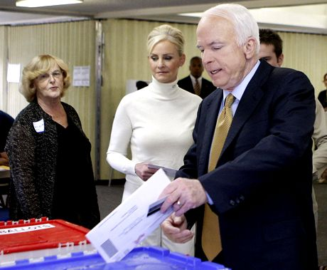 Republican presidential candidate Sen. John McCain, R-Ariz., accompanied by his wife Cindy, votes in the 2008 presidential election at the Albright United Methodist Church in Phoenix, Ariz., Tuesday, Nov. 4, 2008. (AP Photo/Stephan Savoia)