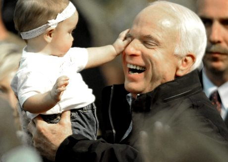 Republican presidential candidate Sen. John McCain, R-Ariz., has his eye poked by Alyssa Howald of Wickliffe, Ohio during a rally at Mentor High School in Mentor, Ohio, Thursday, Oct. 30, 2008. (AP Photo/David Richard)
