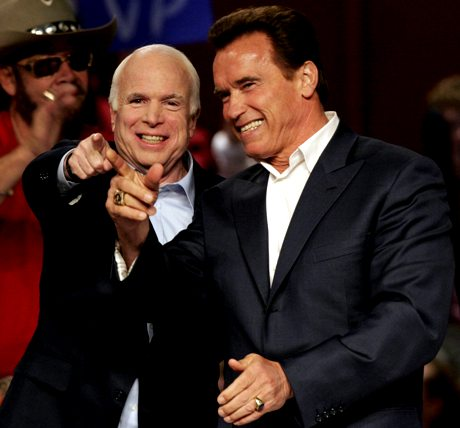 Republican presidential candidate Sen. John McCain, R-Ariz., left, and California Gov. Arnold Schwarzenegger arrive at a rally Friday, Oct. 31, 2008 at the Nationwide Arena in Columbus, Ohio. (AP Photo/Kiichiro Sato)