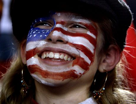 Teresa Williams, 14, smiles up at Republican presidential candidate Sen. John McCain, R-Ariz., as he speaks at a rally in Perkasie, Pa., Saturday, Nov. 1, 2008 at the Pennridge Airport. (AP Photo/Carolyn Kaster)