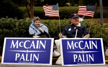 Gail and Phil Pillips of Fairhope, Ala., do some last minute campaigning for John McCain outside the polling station at the Fairhope Civic Center on Tuesday, Nov. 4, 2008. (AP Photo/Press-Register, Kate Mercer)