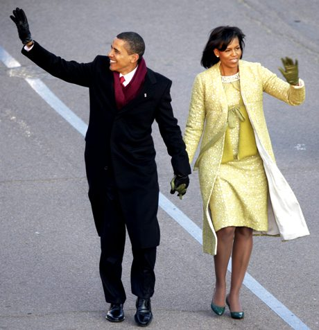 President Barack Obama and his wife Michelle walk on Pennsylvania Avenue near the White House in Washington, Tuesday, Jan. 20, 2009, during his inaugural parade. (AP Photo/Jae Hong)