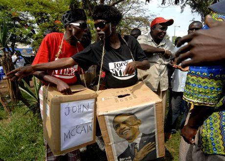 "Members of the ""Big Tyme Comedians"", carrying cardboard boxes representing ballot boxes for U.S. presidential candidates Sen. John McCain, at left, and Sen. Barack Obama, at right, are seen as they a stage a mock U.S. presidential election, in Kisumu, Kenya, Tuesday, Nov. 4, 2008. From the capital, Nairobi, to this bustling city near Barack Obama's ancestral home, Kenyans were abuzz Monday about the man they see as a ""son of the soil"", and ready to erupt in celebration if he wins the U.S. presidential election. (AP Photo/Riccardo Gangale)"