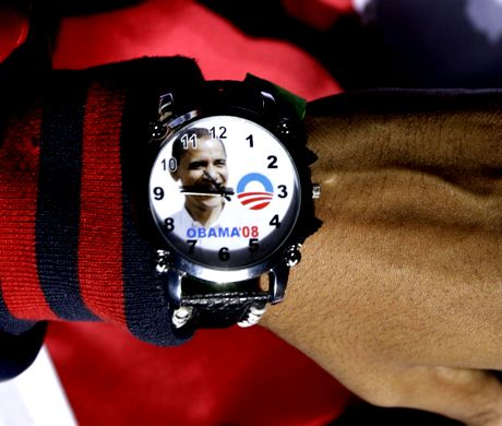 A supporter wears a watch for Democratic presidential candidate Sen. Barack Obama, D-Ill., as he speaks at a rally at the Prince William County Fairgrounds in Manassas, Virg. Monday, Nov. 3, 2008.(AP Photo/Alex Brandon)