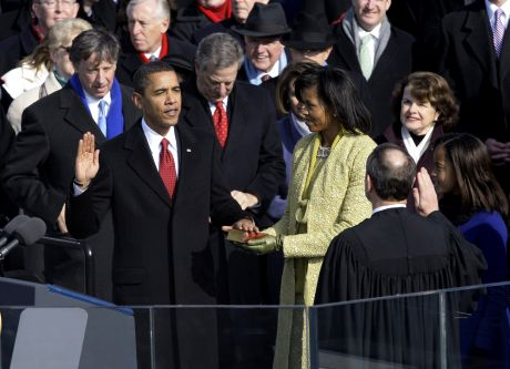 Barack Obama, left, joined by his wife Michelle, second from left, and daughters Sasha, third from left, and Malia, takes the oath of office from Chief Justice John Roberts to become the 44th president of the United States at the U.S. Capitol in Washington, Tuesday, Jan. 20, 2009. (AP Photo/Elise Amendola)
