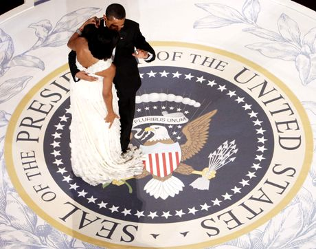 President Barack Obama gets caught in first lady Michelle Obama's dress train as they dance at the Commander in Chief Ball at the National Building Museum in Washington, Tuesday, Jan. 20, 2009. (AP Photo/Charles Dharapak)