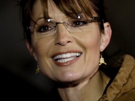 Republican vice presidential candidate and Alaska Gov. Sarah Palin smiles as she talks to reporters after she voted Tuesday, Nov. 4, 2008, at Wasilla City Hall in Wasilla, Alaska. (AP Photo/Ted S. Warren)